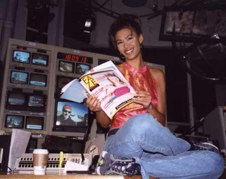 Much Music VJ Juliette Powell reading the premier issue of Faze Magazine