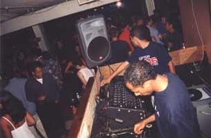 DJ at a nightclub bar