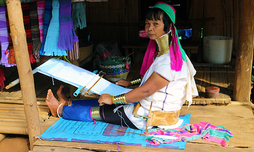 Long-Neck Karen Hill Tribe woman making a scarf