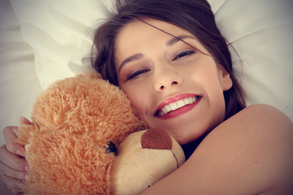 smiling-woman-with-teddy-bear