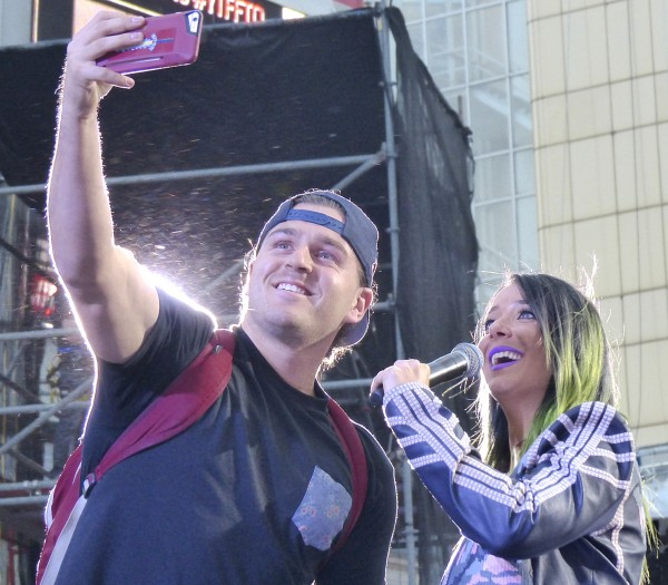 Jenna Marbles takes a selfie with the crowd