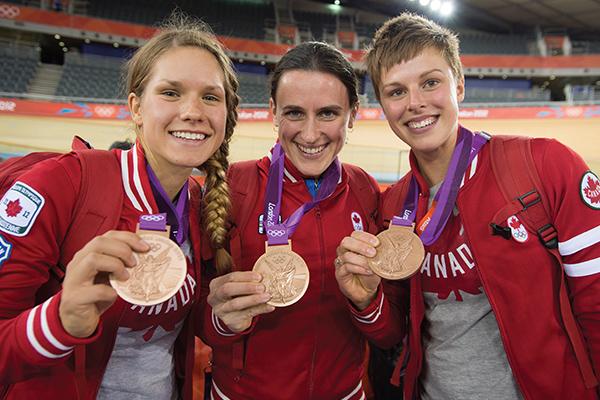 Tara Whitten, Gillian Carleton, Jasmin Glaesser showing off their Olympic cycling medals
