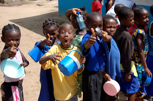 ETFL Eat To Feed Liberians Africa: waiting in line for food--what's not to love about these kids?!