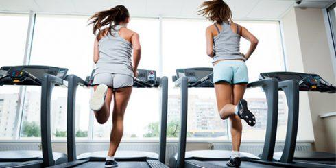 Girls Running on Treadmill at Gym