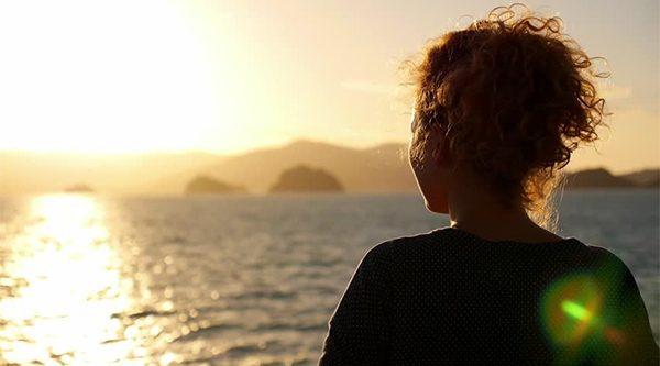 Girl watching sunrise sunset